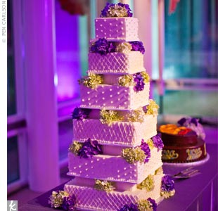 The six-tiered cake was frosted with pink champagne-colored buttercream and decorated with fresh purple and green hydrangeas.