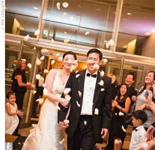 The couple made their way to the bridal suite at the Hotel Palomar in Dallas, but not before guests showered them with rose petals.