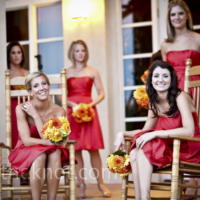 The bridesmaids wore strapless dresses in a pretty orange color and simple gold necklaces that Jennifer gave them.