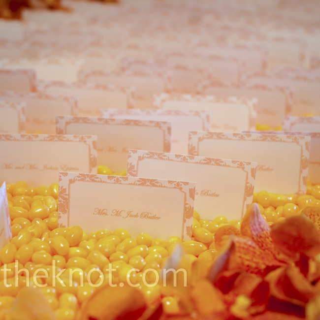The escort cards were displayed on trays full of orange jelly beans.