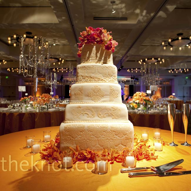 Their cake was decorated with soft peach fondant and damask appliques and topped with fresh flowers.