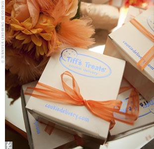 The couple's friends own a cookie company, so the favors were gift boxes of fresh chocolate chip and snickerdoodle cookies.