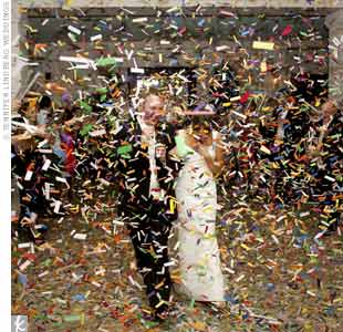 As the couple made their exit, guests threw confetti poppers, drenching them in a flurry of colored paper.