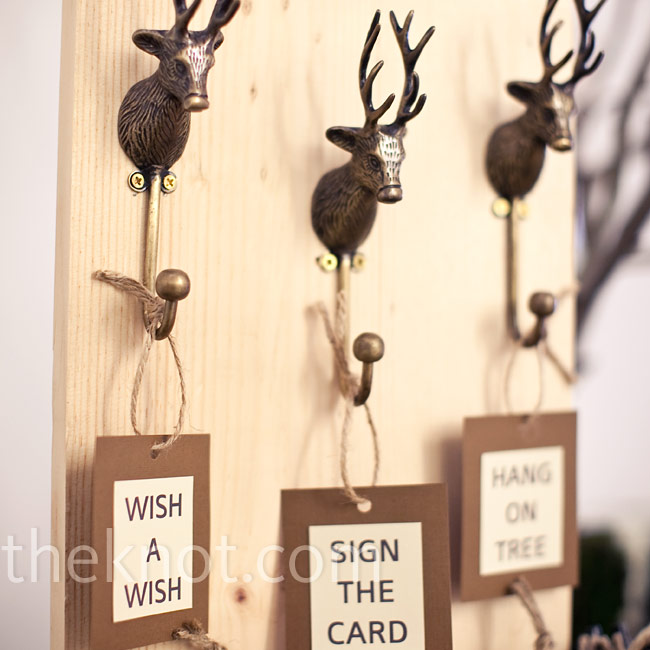 Katie's mom mounted small deer hooks, which held instructions for contributing to the couple's guest book tree.