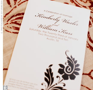 They used this same black flower design (reminiscent of their reception venue) on the programs, invites, and escort cards.
