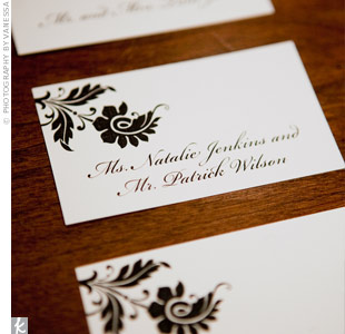 The black flower design from the programs appeared on the escort cards. Guests' names were printed in elegant black calligraphy.