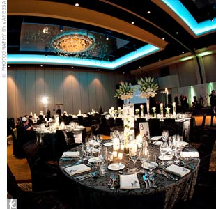 The menus and table numbers coordinated not only with the black tablecloths but with the venue's starry night-like ceiling, giving the room a cohesive feel.