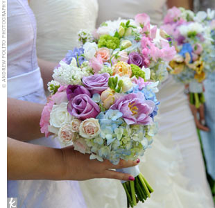 The bridesmaid bouquets were a sweet combination of pastel peonies, roses, sweet peas, hydrangeas, tulips, and ranunculus.