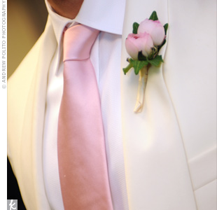 Troy wore two pink ranunculus on his lapel to match his tie and complement his formal suit.