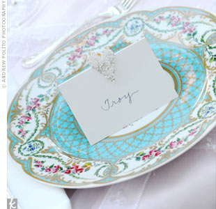 Samantha loved the Sevres porcelain plates for their feminine, garden feel. Her mom picked out the place cards and, in sticking with the theme, they had little hearts at the top.