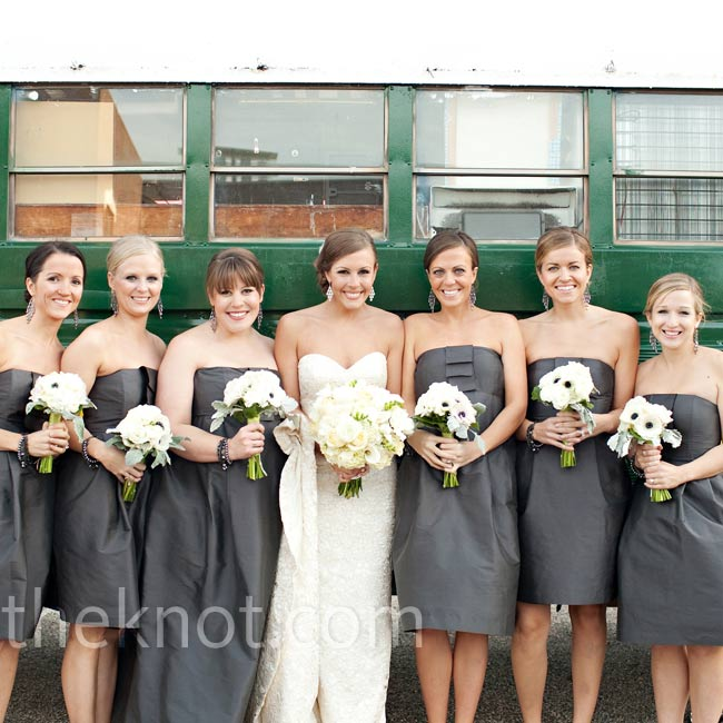 Sarah's bridesmaids wore strapless charcoal dresses with matching chandelier earrings and carried bouquets of white anemones, green lamb's ear and galax.