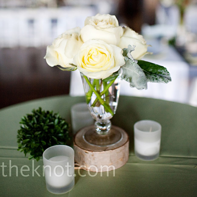 Pine cone accents and a mix of short and tall centerpieces placed on tiny birch stumps contributed to the wintry theme.
