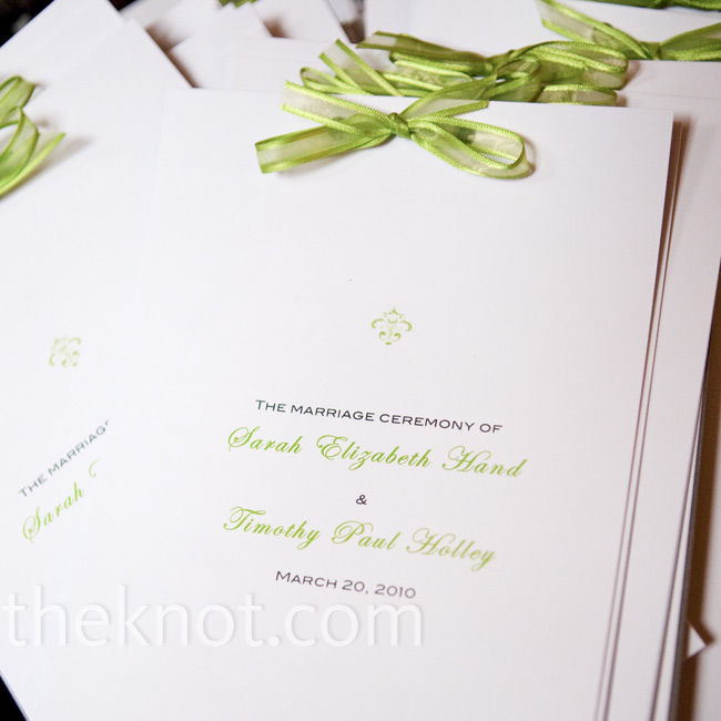 Sarah made the programs herself. The simple white sheets were printed in green and gray type and tied off with small green bows.