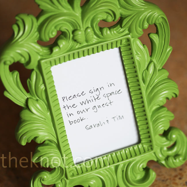 Small green details, like this bright green frame, gave the wedding a cohesive look and feel.