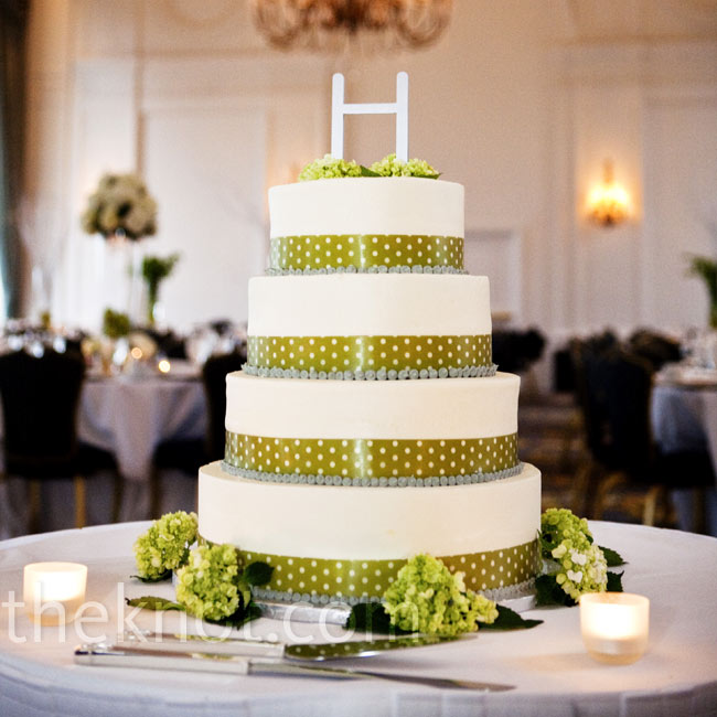 In keeping with the modern theme, Sarah wanted clean lines for the cake with just a hint of embellishment -- a polka-dotted ribbon and a silver H monogram.