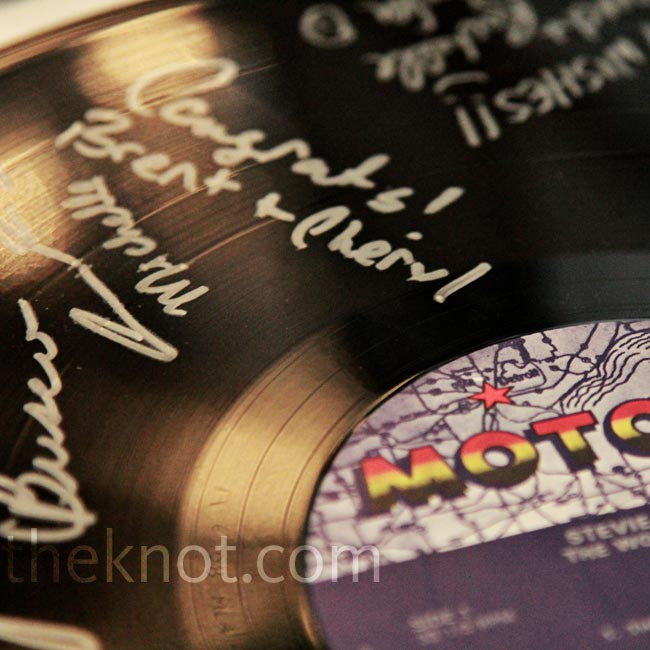 Instead of a traditional guest book, they choose a vinyl Motown record and had their guests write notes on it with a Sharpie.