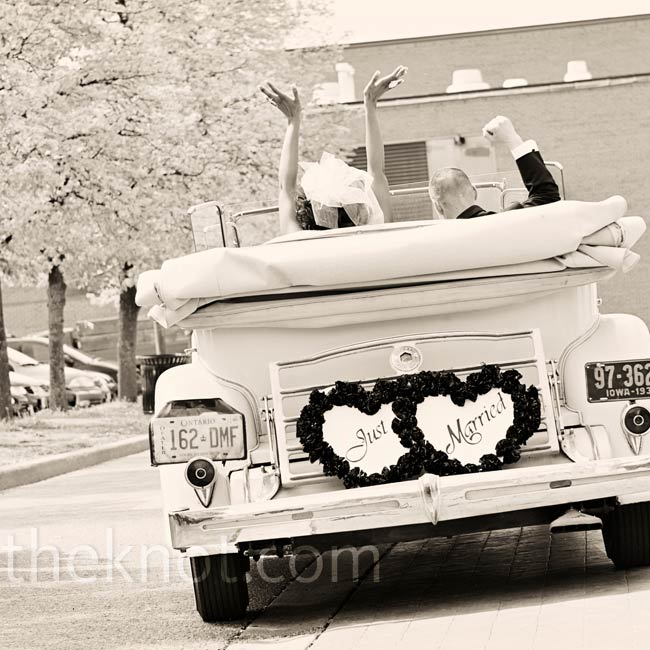 The couple left the reception in a classic 1934 ivory Packard, decorated with a simple Just Married sign hanging on the back.