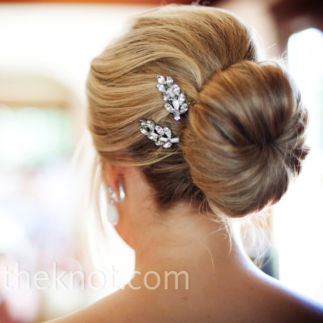 Ruby wore her hair up in a soft, romantic low-swept bun secured with crystal pins (which were actually clip-on earrings!) that her mother found at an antique store.