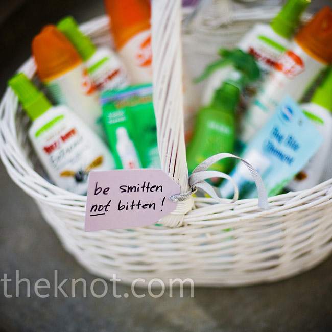 "A wicker basket of bug spray was set out for the guests to use with a card that read ""be smitten not bitten."""