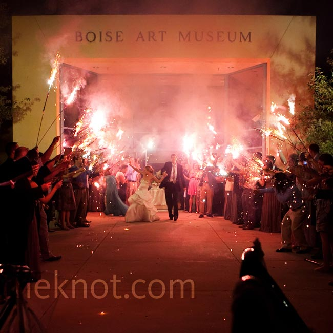 The couple's send-off in front of the Boise Art Museum was full of sparklers. The getaway car took the couple to the low-key after party at Chandeler's Steakhouse.