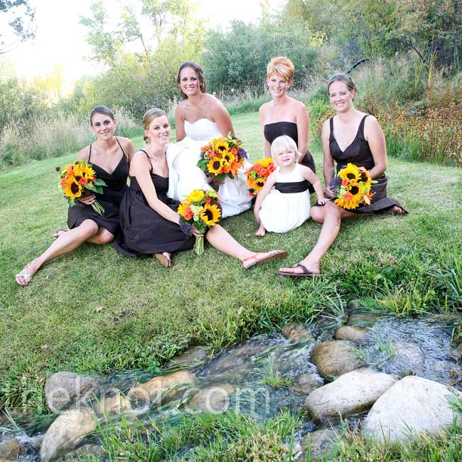 The bridesmaids each picked out a brown silk taffeta dress from J.Crew in their favorite style. The flower girl wore an off-white dress with a brown sash.