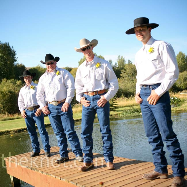 The groomsmen dressed in the part of the casual western wedding in Wranglers blue jeans and Stetson shirts.