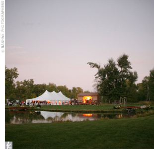 The couple set up a tent on the property for dinner and dancing. The bar area was its own building next to the tent.