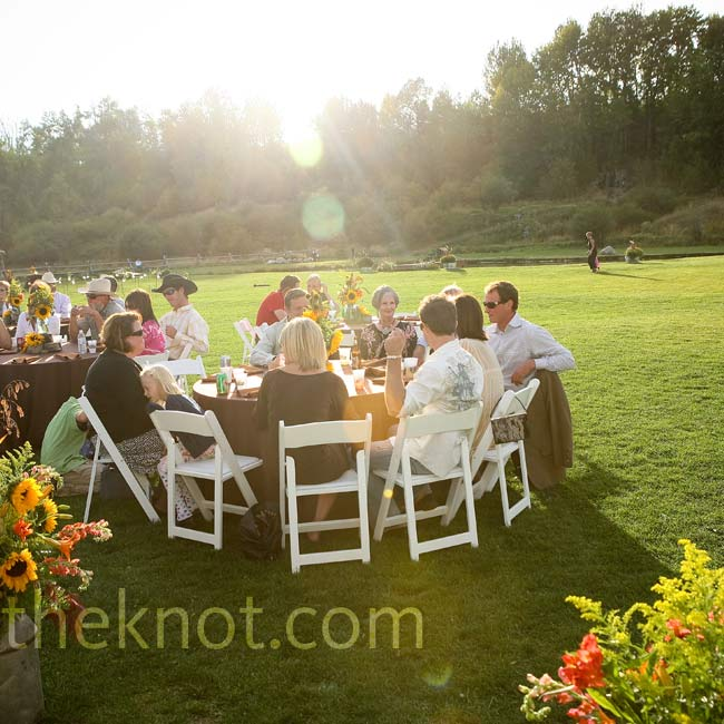 Tables extended from inside the tent onto the grounds outdoors to accommodate all of the guests.