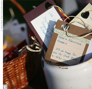 Instead of a traditional guest book, guests were encouraged to write notes to the couple on tags and place them in an old enamel can. The couple later used these as ornaments on their first Christmas tree.