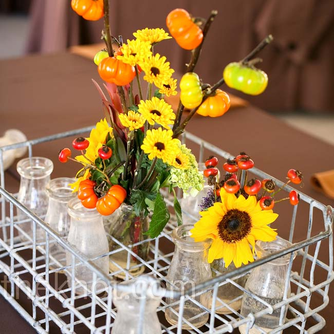 The centerpiece for the head table was an old milk bottle crate filled with flowers and candles.