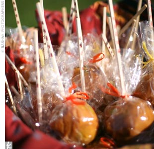 As favors for the fall wedding, the guests enjoyed caramel apples tied with colored ribbon.