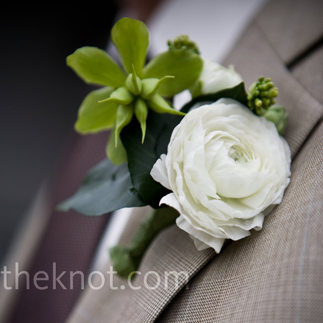 Donna chose to keep the flowers in calm earth tones. Chad and the rest of the groomsmen wore single ranunculus on their lapels.