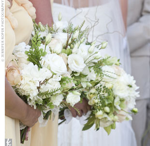 All the girls carried soft, white bouquets of roses, hydrangea, dahlias, and ranunculus.