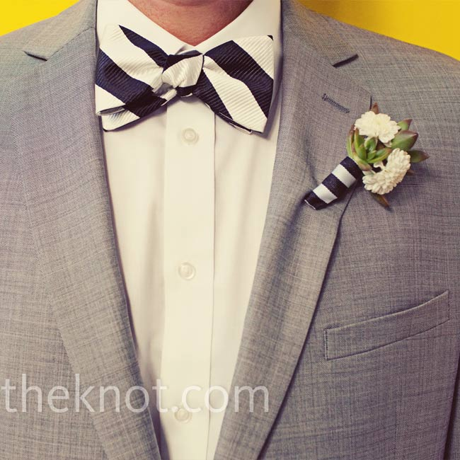 Craig's succulent and button pom-pom boutonniere was tied with black and white ribbon to match his striped bow tie.