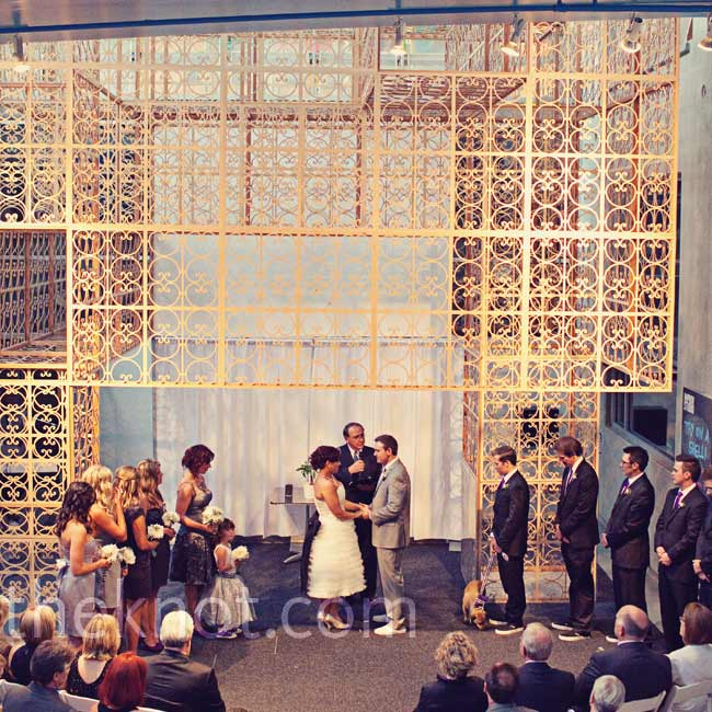 The couple exchanged vows on the first level of the NCM, beneath one of their favorite museum features -- this tall wooden sculpture.
