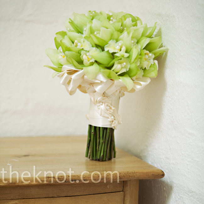 Since a green orchid bouquet inspired the wedding's color combo, Morgan had an easy decision to make when it came to what she would carry. Her orchids were wrapped in cream-colored satin ribbon.