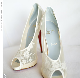 Morgan loves shoes, so she splurged on a pair of Christian Louboutin peep-toe pumps made of lace and satin. Since the ceremony was on the beach, though, she ending up wearing her rainbow sandals for most of the day and night.