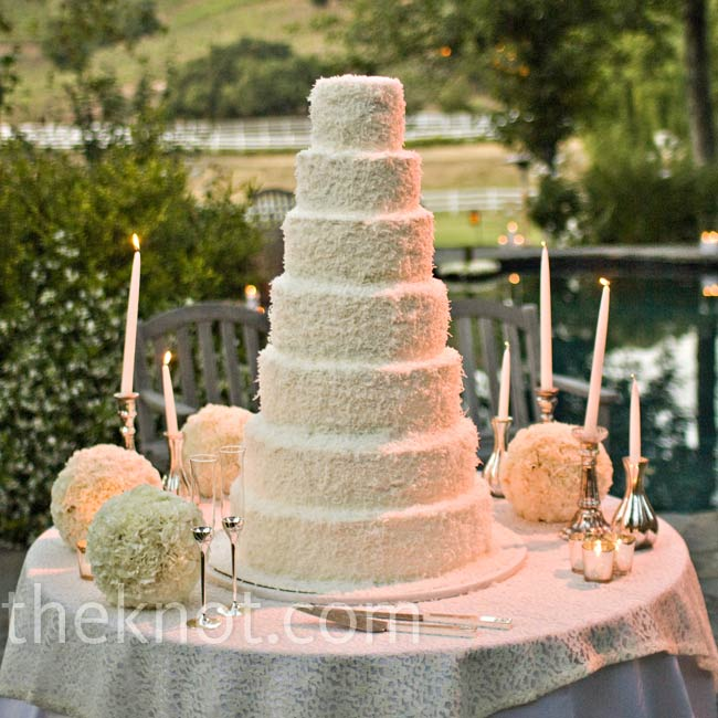 The couple needed a cake that would stand out among the sweets at their dessert-only reception, so they picked this seven-tiered shaved-coconut wonder.