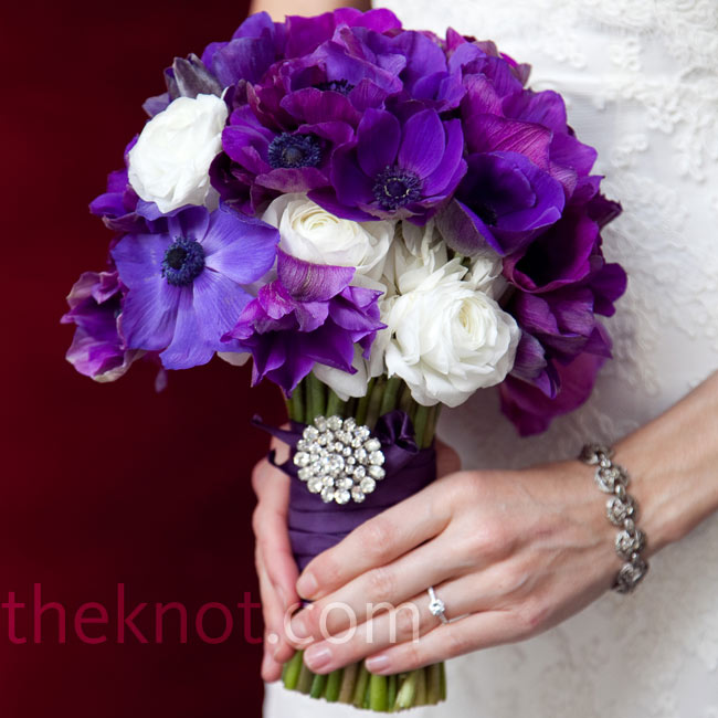 Julie carried purple anemones mixed with white ranunculus and attached an antique brooch.