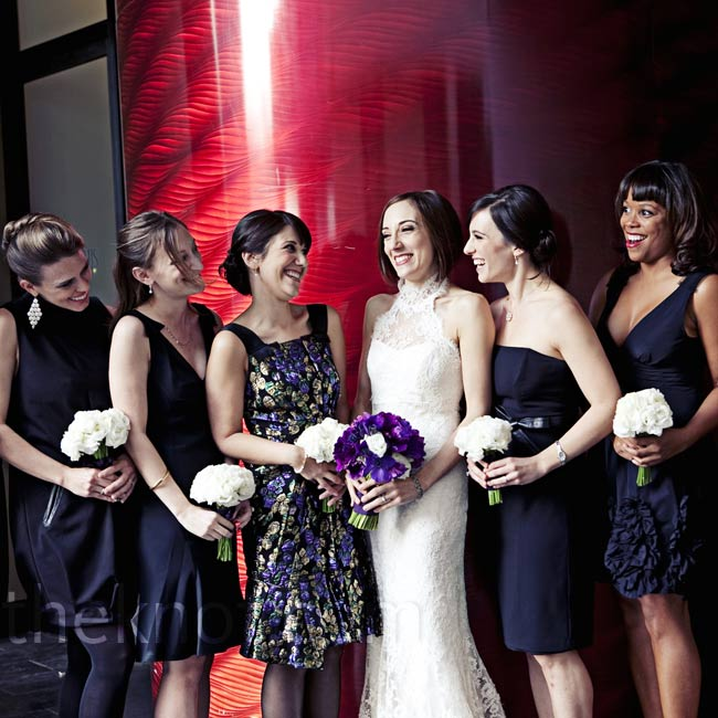 The bridesmaids wore black cocktail dresses, and Julie's sister wore a dress that matched the color scheme.