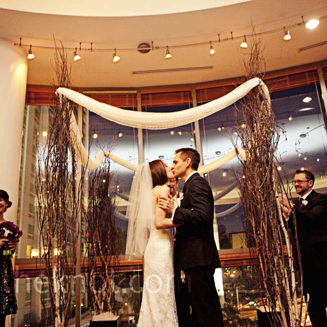 The couple exchanged vows in the Vantage Dining Room. Their huppah of willow branches was draped with antique lace.