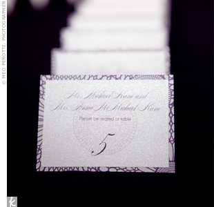 A cursive font gave these purple tented escort cards more of a formal vibe.
