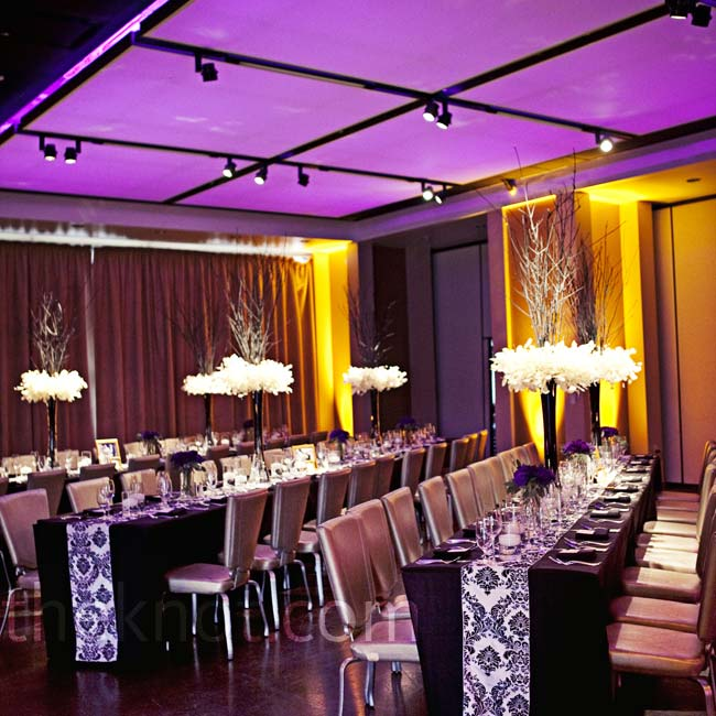 The long reception tables were topped with damask-patterned table runners.