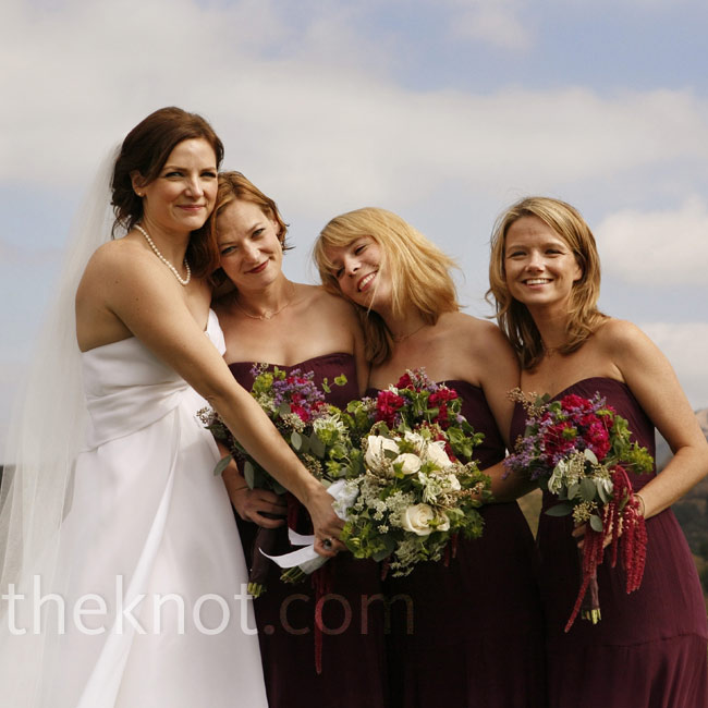 Rebecca's three bridesmaids wore strapless, floor-length gowns in eggplant and held matching bouquets of purple and pink blooms.
