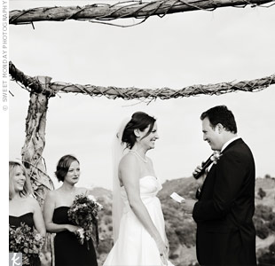The couple exchanged vows on a hill, surrounded by vines and overlooking valley. With such a gorgeous backdrop, they kept the decor simple.