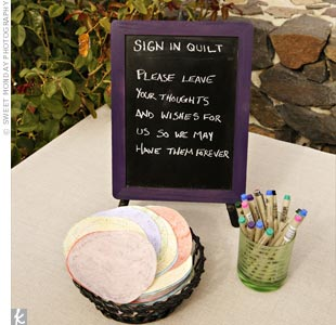Jason's mom made fabric circles for guests to write on. After the wedding, she turned them into a quilt.