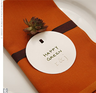 At their places, guests found embossed paper circles and tiny succulent plants tucked neatly into the reception napkins.