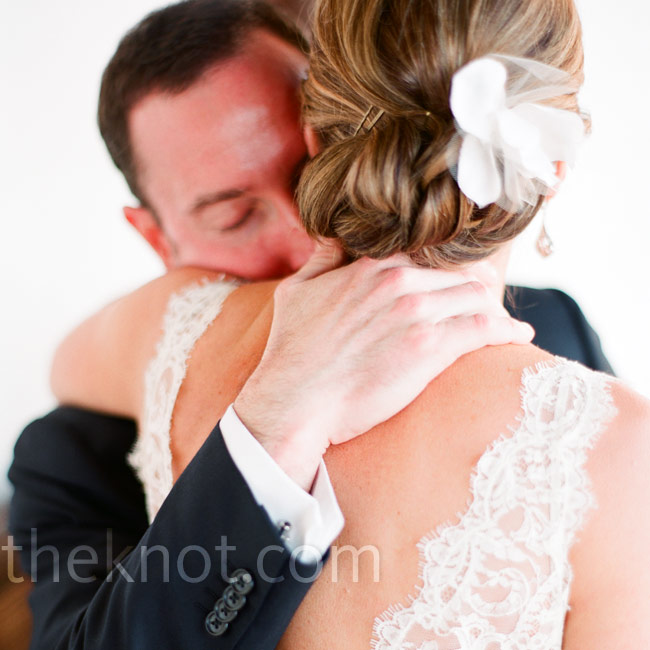 Susannah wore her hair in a low bun fastened with a white fabric flower.