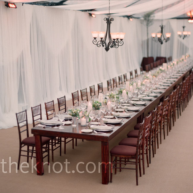 To achieve a family dinner vibe, guests sat at two long dining tables. Chandeliers and spot lighting helped set an intimate tone.
