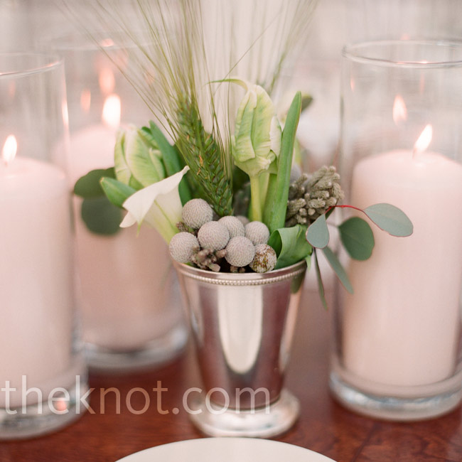 The reception tables were decorated with candles and simple arrangements in low silver containers.